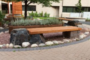 Black Granite | Boulder | Wood Bench | B. Rocke Landscaping | Winnipeg, Manitoba